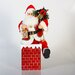 <strong>A/C Musical Animated Chimney Santa</strong> by Sterling Inc.