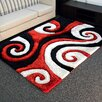 DonnieAnn Company Shaggy Red/Ivory Abstract Swirl Area Rug