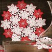 <strong>Xia Home Fashions</strong> Candy Cane Poinsettia Embroidered Cutwork Holiday Placemat (Set of 4)