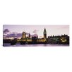 iCanvas Panoramic Buildings Lit Up at Dusk, Big Ben, Houses Of Parliament, Thames River, City Of Westminster, London, England Photographic Print on Canvas