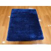 <strong>Mistique Shaggy Navy Tufted Rug</strong> by Merinos Rugs