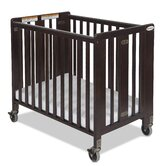 Hideaway Compact Sized Folding Crib in Antique Cherry