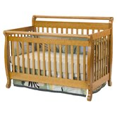 Emily 4-in-1 Convertible Crib with Toddler Rail in Honey Oak