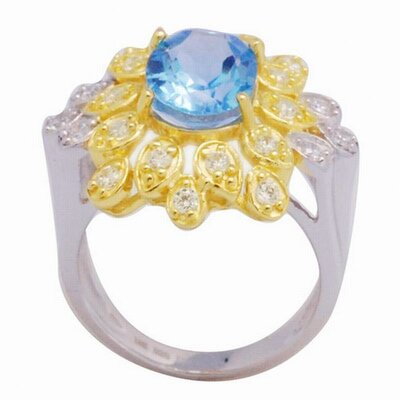 18K Gold and Silver Oval Cut Sapphire and Cubic Zirconia Ring