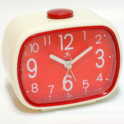 That 70's Retro Alarm Clock in Cream with Red Face
