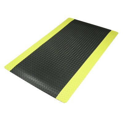 "Superior Manufacturing 3' X 12' Black 9/16"" Thick Cushion Trax® Dry Area Anti-Fatigue Floor Mat With Yellow Border"