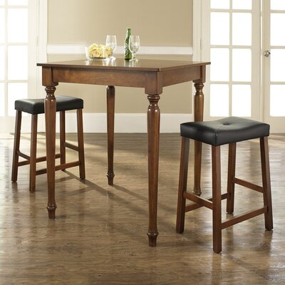 Crosley Three Piece Pub Dining Set with Turned Leg Table and Saddle Seat Barstools in Classic Cherry