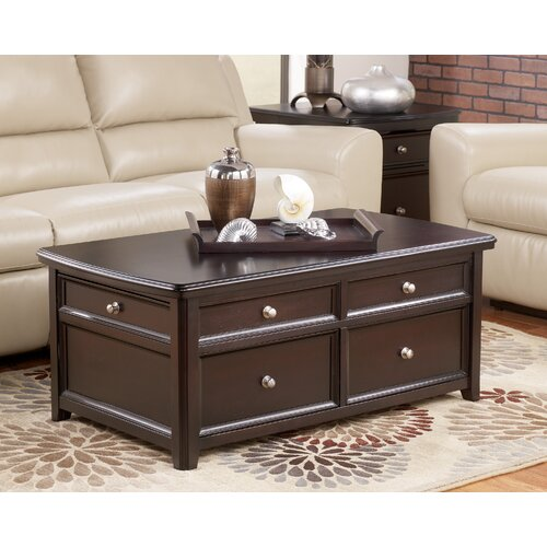 signature design by ashley canaan trunk coffee table with. Black Bedroom Furniture Sets. Home Design Ideas