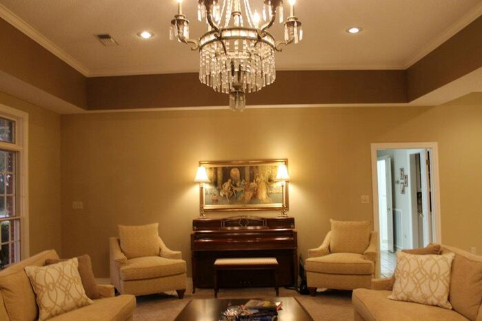 Traditional Living Room photo by Strickland Interiors