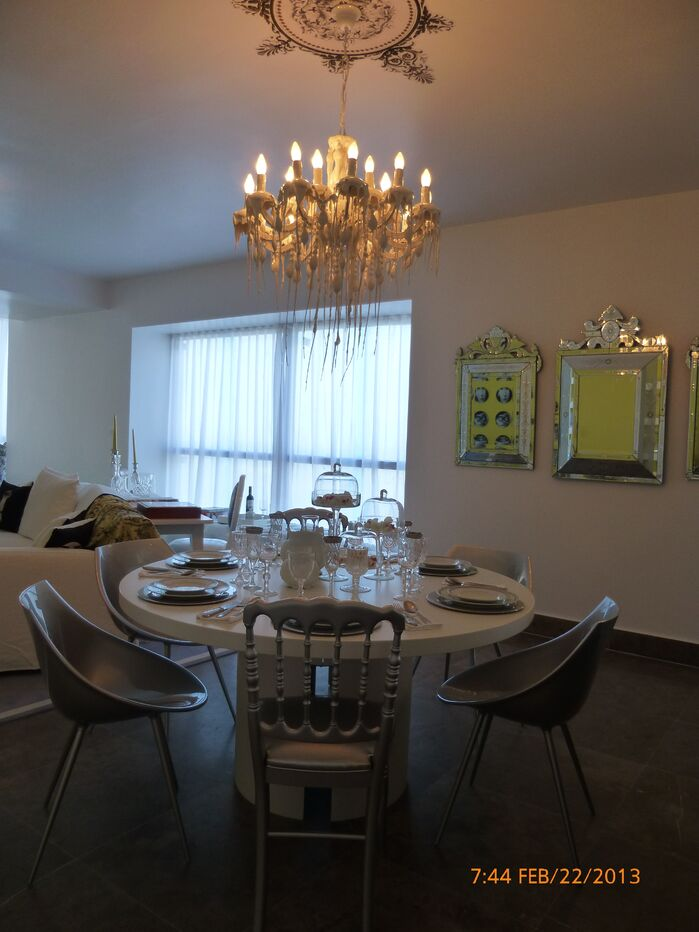 Contemporary Dining room photo by Urvan Studios