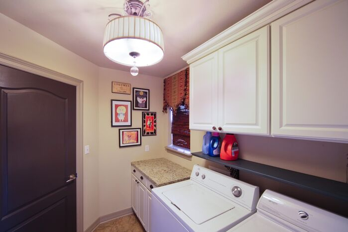 Traditional Laundry/Mud Room photo by red river remodelers