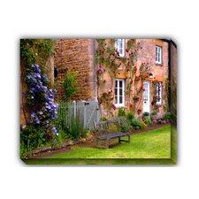 Village Bench Photographic Print on Canvas