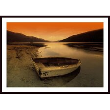 Row Boat At Water's Edge Against Sunset Backdrop Wall Art by Don Hammond