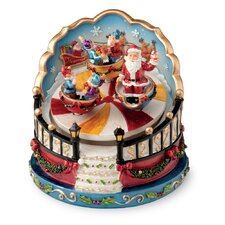 <strong>October Hill</strong> Santa and Elves in Twirling Cups Revolving Musical Figurine
