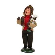 Boy Holding Nutcracker Figurine