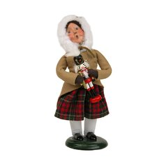 Girl Holding Nutcracker Figurine