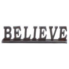"Simple Table with Word ""Believe"" Statue"