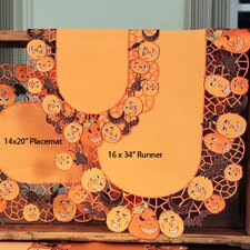 <strong>Xia Home Fashions</strong> Happy Jack-O-Lanterns Table Runner