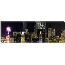 <strong>iCanvasArt</strong> Skyscrapers and Firework Display in a City at Night, Lake Michigan, Chicago, Illinois Canvas Wall Art
