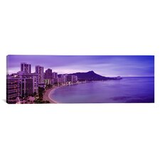 Panoramic Buildings at the Coastline with A Volcanic Mountain Photographic Print on Canvas