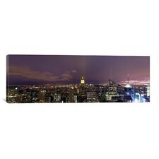 Panoramic Buildings in a City Lit Up at Dusk, Midtown Manhattan, New York City Photographic Print on Canvas