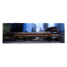 Panoramic Electric Train Crossing a Bridge, Chicago, Illinois Photographic Print on Canvas