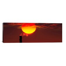Panoramic 'Smoke Stack in Sunset' Photographic Print on Canvas