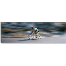 <strong>iCanvasArt</strong> Bike Racer Participating in a Bicycle Race, Sitges, Barcelona, Catalonia, Spain Canvas Wall Art