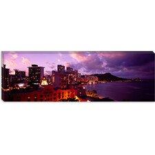 <strong>iCanvasArt</strong> Buildings Lit Up At Dusk, Waikiki, Oahu, Hawaii, Canvas Wall Art