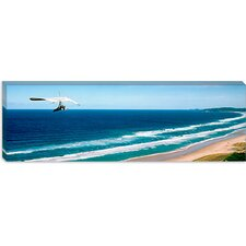 <strong>iCanvasArt</strong> Hang Glider Over the Sea Canvas Wall Art
