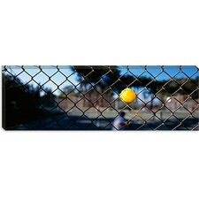 <strong>iCanvasArt</strong> Close-up of a Tennis Ball Stuck in a Fence, San Francisco, California Canvas Wall Art