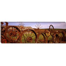 <strong>iCanvasArt</strong> Old Barn with a Fence Made of Wheels, Palouse, Washington State Canvas Wall Art
