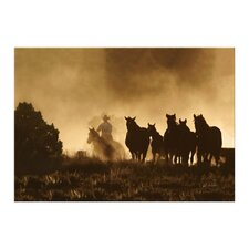 Westward Bound Cowboy Rides the Herd Indoor by Carol Walker Photographic Print on Canvas