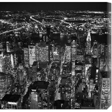 'Night aerial view of midtown Manhattan' by Cameron Davidson Stretched Canvas Art