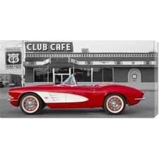 <strong>Bentley Global Arts</strong> Unknown '1961 Chevrolet Corvette at Club Cafe on Route 66' Stretched Canvas Art