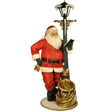 Santa Claus Looking at the Lamp Post Figurine