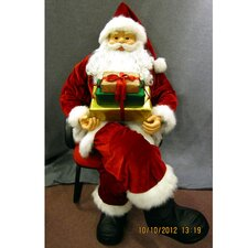 Sitting Santa Holding Presents on Lap