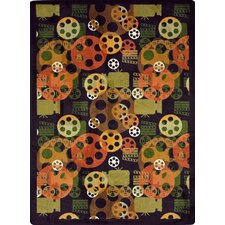 <strong>Joy Carpets</strong> Gaming and Entertainment Blockbuster Plum Novelty Rug