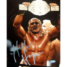 "Hulk Hogan Autographed Raising Belt 8"" x 10"" Photograph"