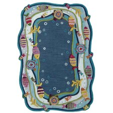Kinder Under the Ocean Blue Area Rug
